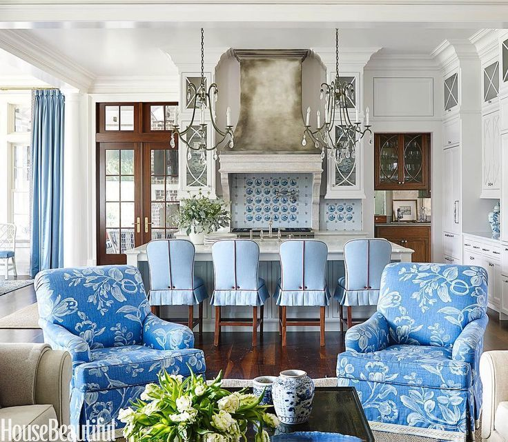 I have a large living room. Ha! Understatement. It's the size of a football field. Not exactly cozy or even welcoming. And I'm struggling to furnish it. Fabulous blue and white family room and kitchen designed by Suzanne Kasler
