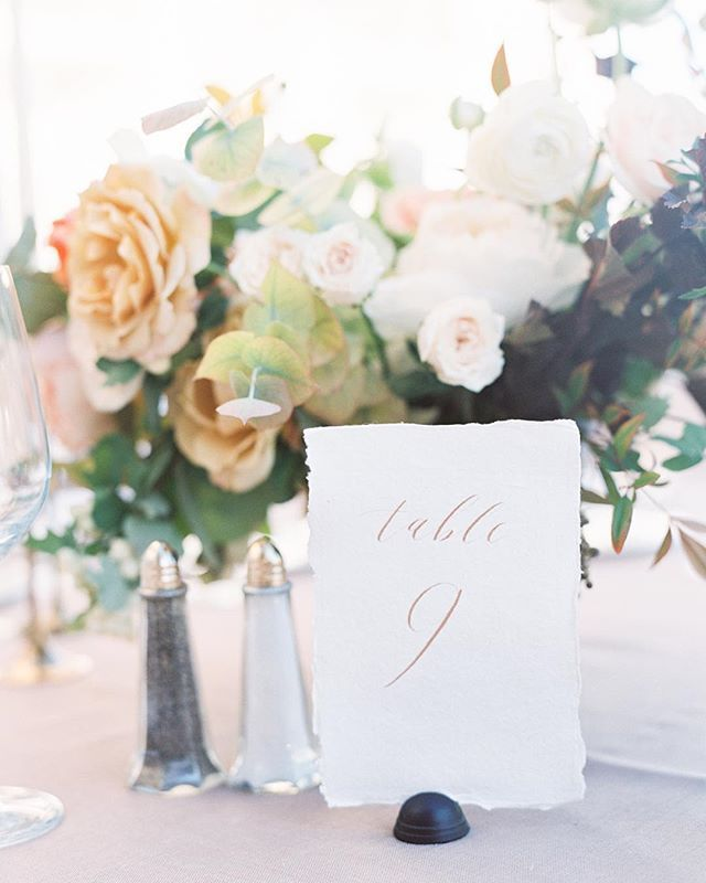 Table numbers with a gorgeous @tingefloral backdrop and amazing light captured by the very talented @darcybenincosa!