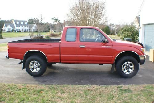 1997 Toyota Tacoma - little, old, and red :)