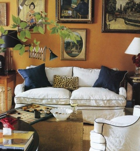 orange walls + cozy white couch...I like!Wall Colors, Living Rooms, Elle Decor, Livingroom, Interiors Design, Miles Redd, Sitting Room, Orange Wall, Design Home