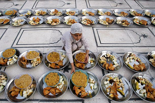 Pakistan In the ninth month of the Islamic calendar, Muslims worldwide observe Ramadan, a period of fasting and other rituals designed to bring self-purification through self restraint and other good deeds. The fasting begins at dawn and lasts until sunset, when observers break their fast with an evening meal called the Iftar. Above, a child lines up food in preparation for the Iftar on the first day of Ramadan at the Memon Mosque in Karachi, Pakistan.