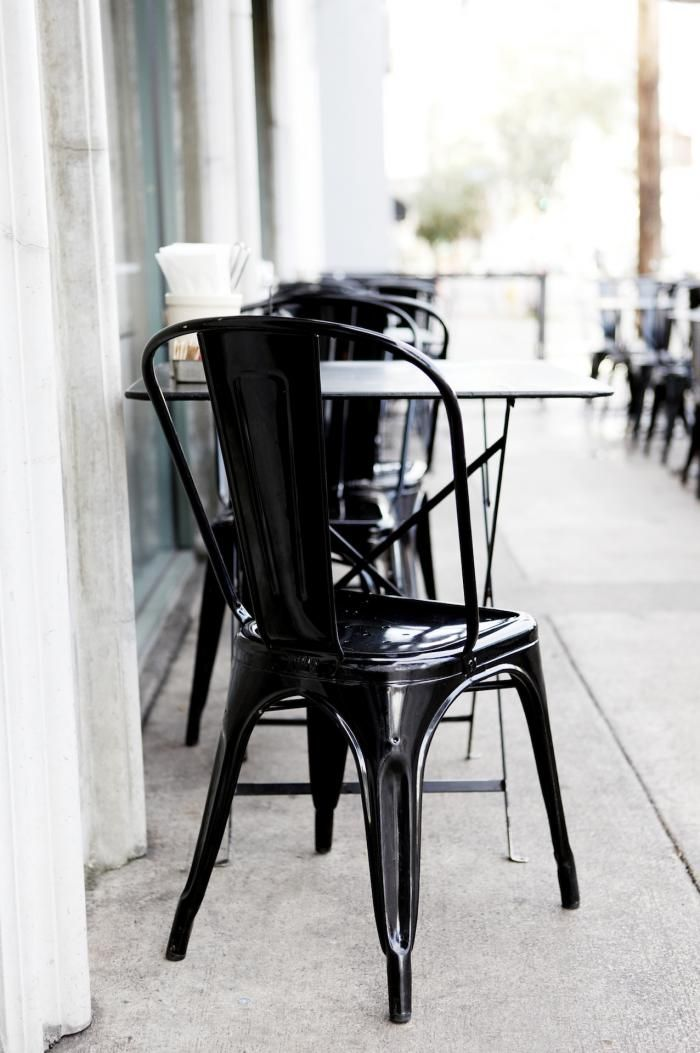 Black Tolix chairs in the outdoor dining area on Third Street at Joans on Third