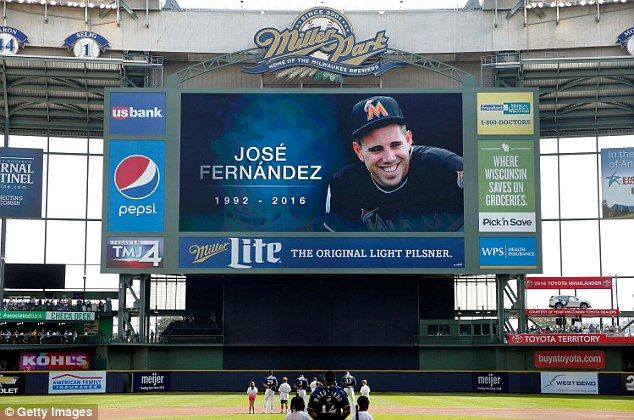 Remembering: The Milwaukee Brewers and Cincinnati Reds also paid tribute as this image was shown on the Miller Park stadium's big screen