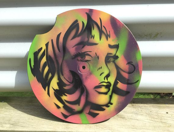 Handmade stencil, spray painted on an upcycled vintage 25cm (10) vinyl record. Has chunk missing from vinyl, due to age. Price reduced.  One off colours,