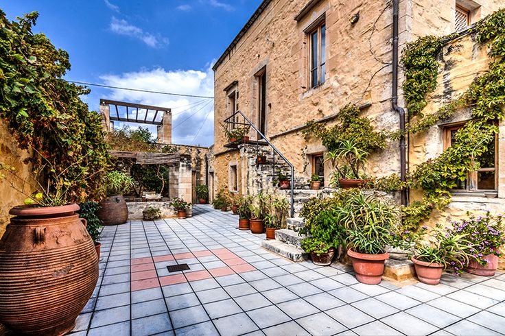 The beautiful courtyard of Alexandrou house, full of aromatic plants and flowers
