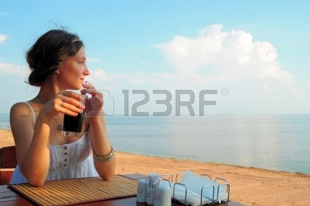 girl in a cafe by the sea