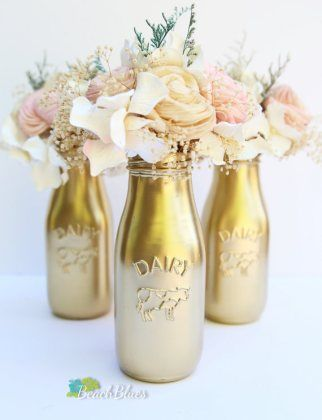 @suzettemccall  milk bottles wedding decor, these are the same bottles on sale at Michaels for $2 just spray painted!