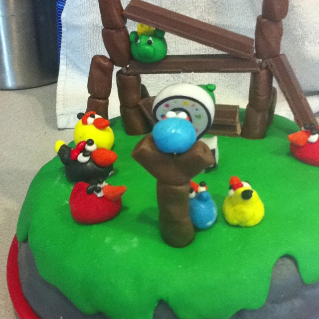 Axl's birthday cake. I used tootsie rolls and kit kats to build the towers and marshmallow fondant to make the birds.