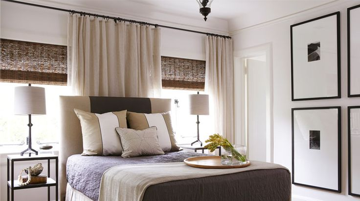 Liz Hand Woods Interiors. Love the bed against window with curtains behind.