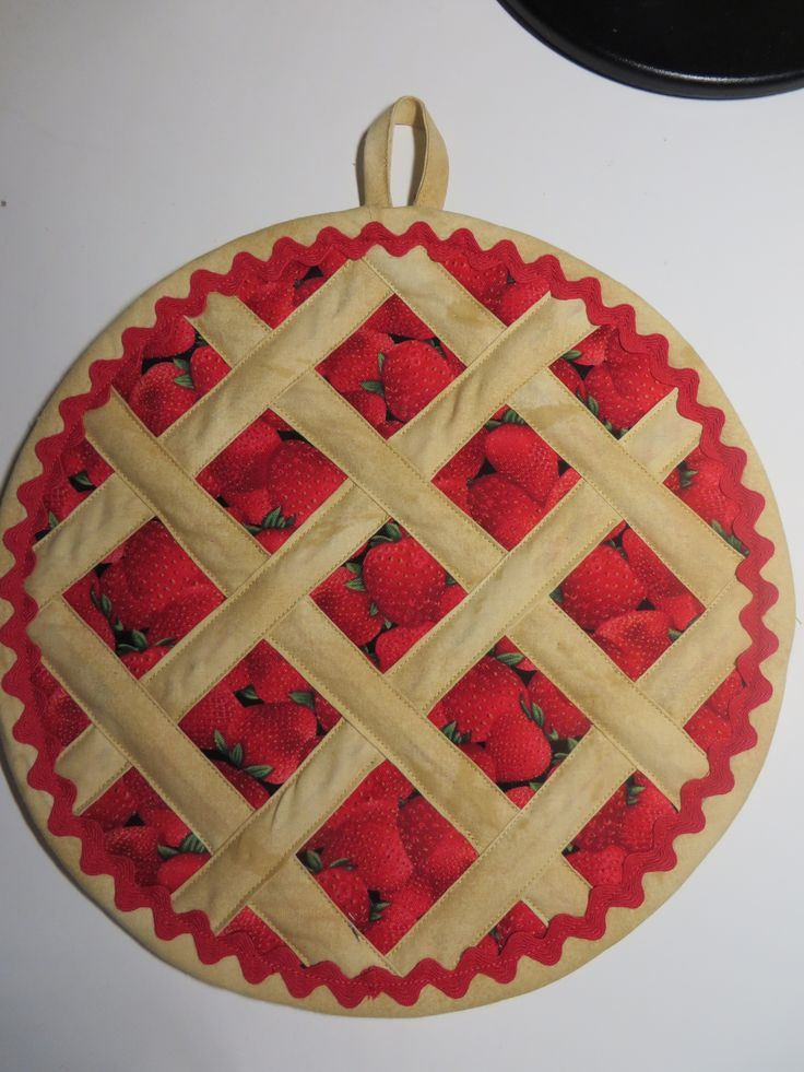 Saw this in a quilting magazine and found some directions on the web.  Fun potholder strawberry pie!