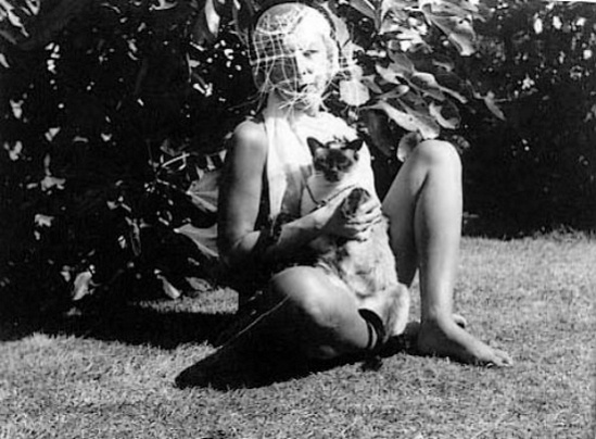 Claude Cahun with her cat, 1938