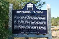 Rosewood is a former populated place in Levy County, Florida, United States. The site is located just off State Road 24, approximately 1 mile (1.6 km) northeast of Sumner and 9 miles (14 km) northeast of Cedar Key.[1] The town was destroyed by whites and subsequently abandoned in 1923 as a result of a white woman claiming a black man had raped her, which resulted in the Rosewood massacre.