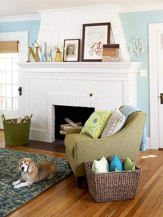 A white fireplace adds contrast to this pretty living room. More decorating ideas: http://www.bhg.com/decorating/color/colors/decorating-with-color-expert-tips/#page=7