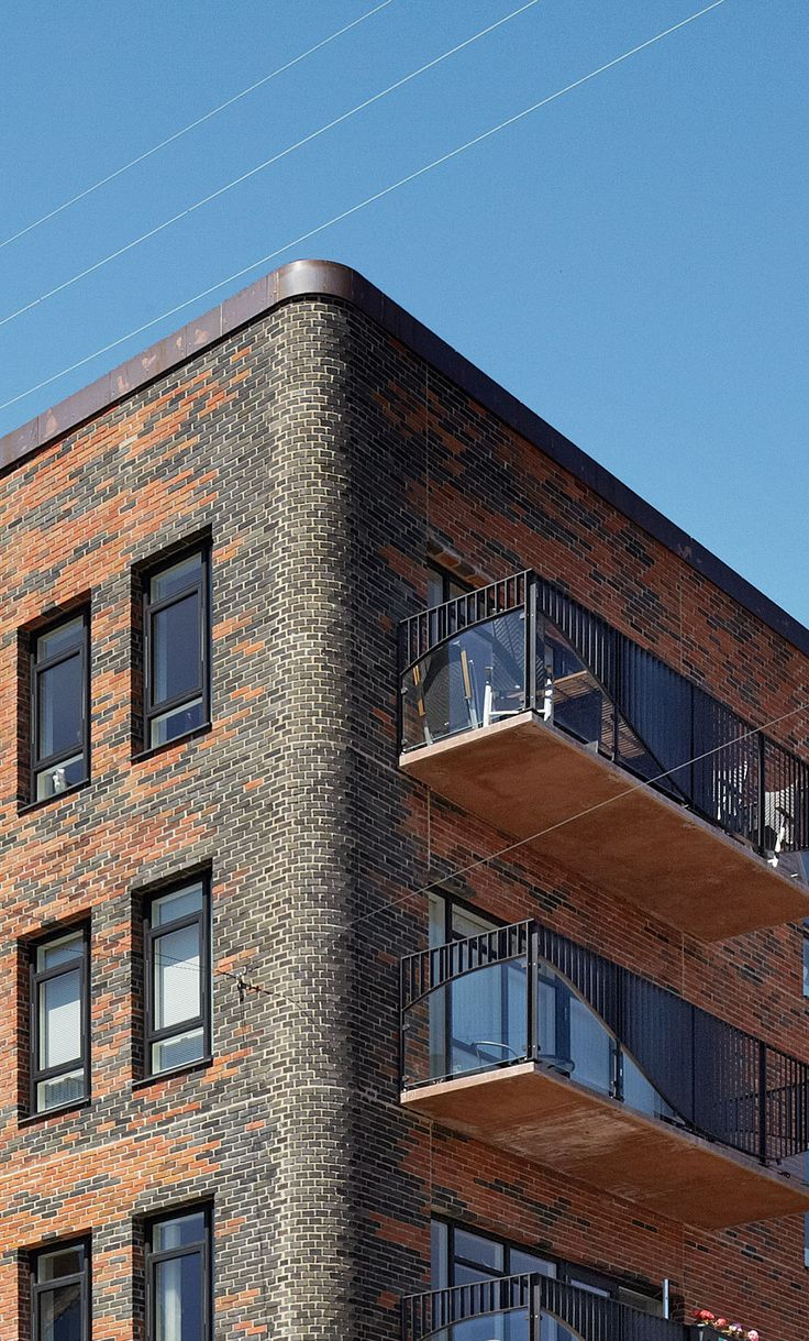 Organic brickwork | Architecture at Stylepark. I love dark brick!