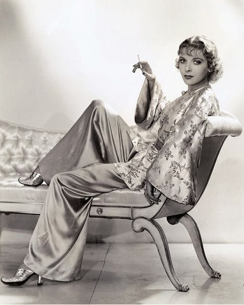 Elegant 1930s evening wear- luxurious, satin wide-legged trousers worn with an embroidered jacket with flared sleeves inspired by classic Chinese silk jackets. Ida Lupino 1930s:
