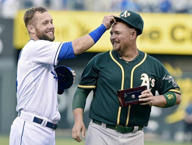 Kansas City Royals left fielder Alex Gordon (4) puts the hat back on Oakland Athletics designated hitter Billy Butler (16) after Butler received his American League Championship ring before Friday's baseball game on April 17, 2015 at Kauffman Stadium in Kansas City, Mo.