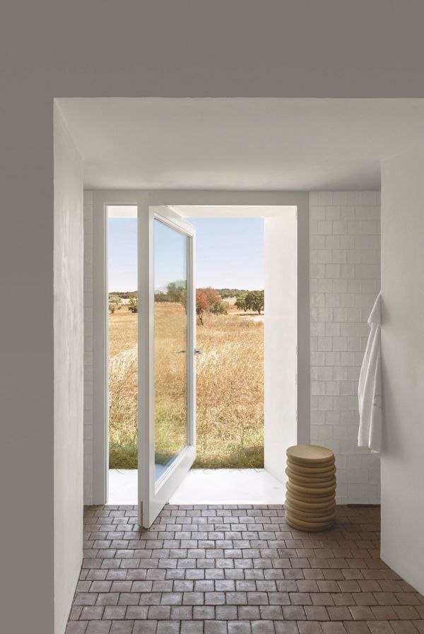 AN OLD FARMHOUSE BECOMES A DREAM HOME IN PORTUGAL | door in bathroom - style-files.com | Bloglovin'