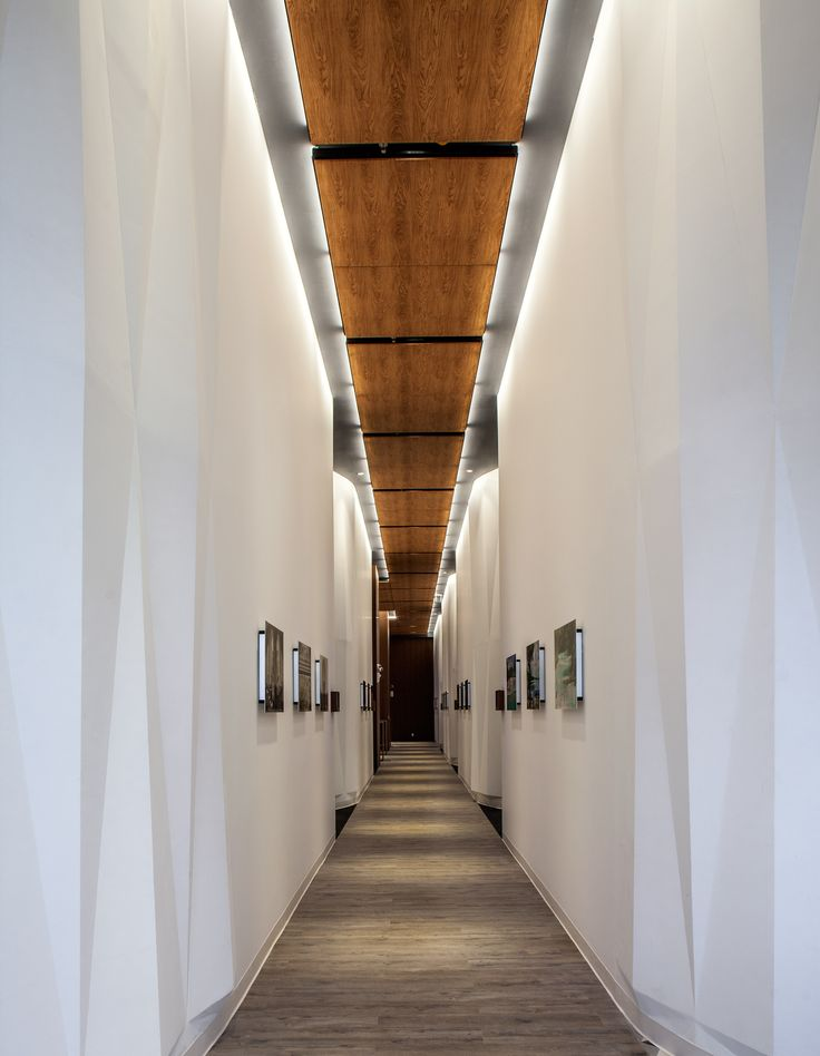 Explore the Deloitte Centro de Excelencia in Mexico City designed by Serrano Monjaraz Arquitectos that features Techstyle® Wood ceiling systems.