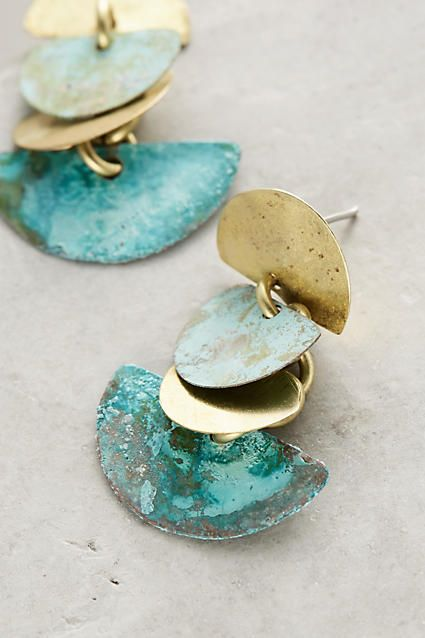 aahhhhh!!!! stunning!! oxidised copper perhaps!?with brass, and soldered silver posts. drool.