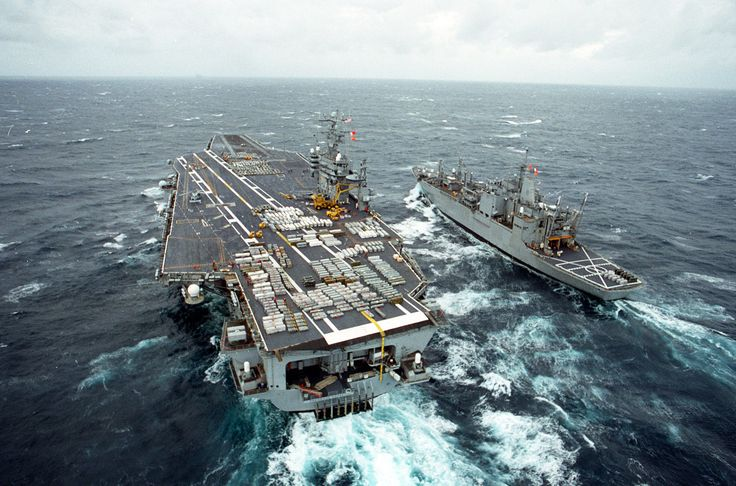 The U.S. Navy aircraft carrier USS Theodore Roosevelt (CVN 71) conducts a Vertical Replenishment weapons on-load with the ammunition ship USS Santa Barbara (AE 28) as they steam in the waters off the Virginia coast on Dec. 20, 1995. The crates of ordnance are being transferred from the Santa Barbara to the Roosevelt by using a CH-46 Sea Knight helicopter.  DoD photo by Petty Officer 2nd Class Michael Tuemler, U.S. Navy.