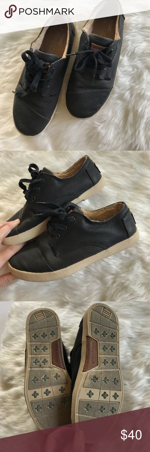 TOMS black leather sneakers Black lace up sneakers. Inside is lined. Toms Shoes Sneakers