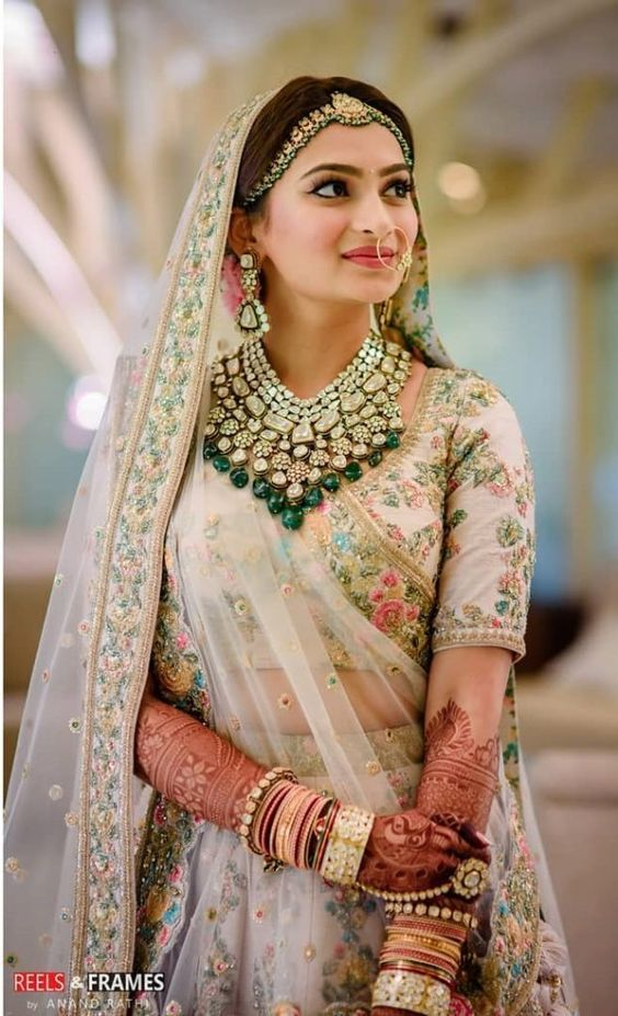 Gorgeous Indian Bride In A Designer Pastel Lehenga with floral embroidery