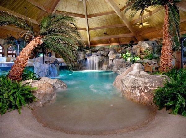Piscine intérieure grotte exotiques palmiers de l'île