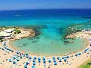 Small beach outside our hotel - Pernera beach, Cyprus where i mistakenly thought i'd suddenly acquired swimming ability. Having then nearly drowned in the hotel pool it turns out my magical feat was simply due to the floatation benefits of saltwater!!