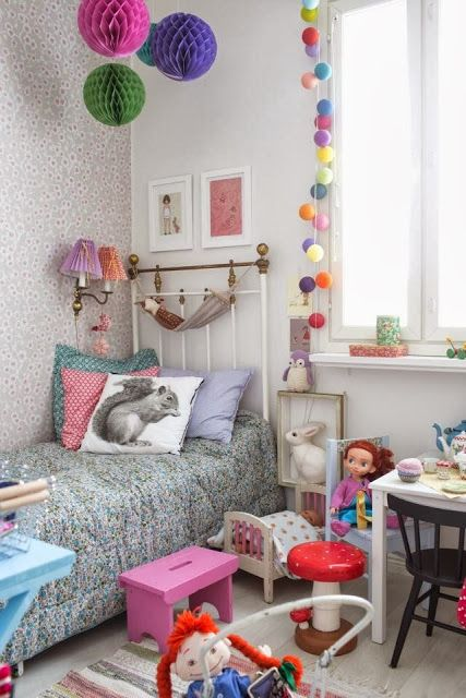 Love the paper decorations and colourful fairy lights for Megan's room.