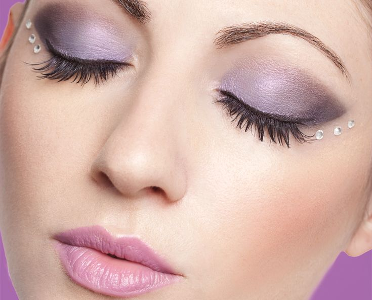 Purple smoky eyes and long lashes