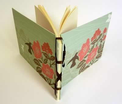 book binding- paper,cardboard, ribbon,hole punch, glue stick, scissors, ruler, bull clips & in just 13 steps.