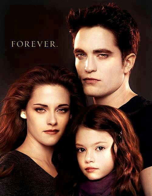 Twilight Saga - Edward, Bella & Renesmee Cullen. Will Bella just stop having hair stupid hair back like malcomore. It's just hideous.