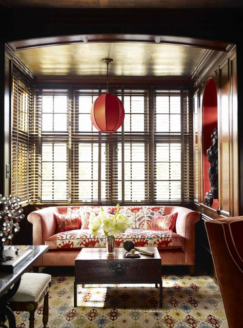 This the perfect balance of color and pattern . . . the dark wood is really lovely in this room and give a feel of elegance!!