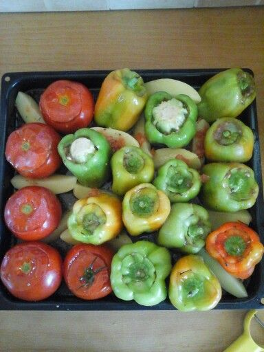 "Greek food ""gemista"". Peppers and tomatoes filled with rice, meat and mediterramean spices. Yummy"
