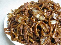Shanghai noodles are thick and chewy. At Chinese restaurants, they are usually darkly coloured and stir fried with thin strips of pork and cabbage. Since the noodles are so thick, they don'…