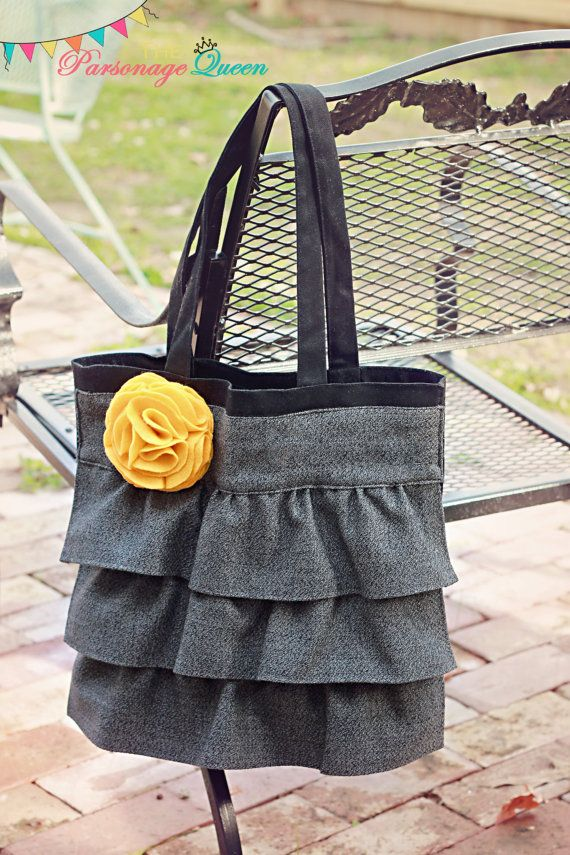 Charcoal Tweed Ruffled Tote Bag with removable Mustard Felt Flower Pin and Cell Phone Pockets Inside. $25.00, via Etsy.