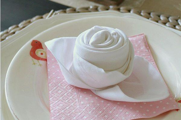 How to fold a napkin into a rose bud.
