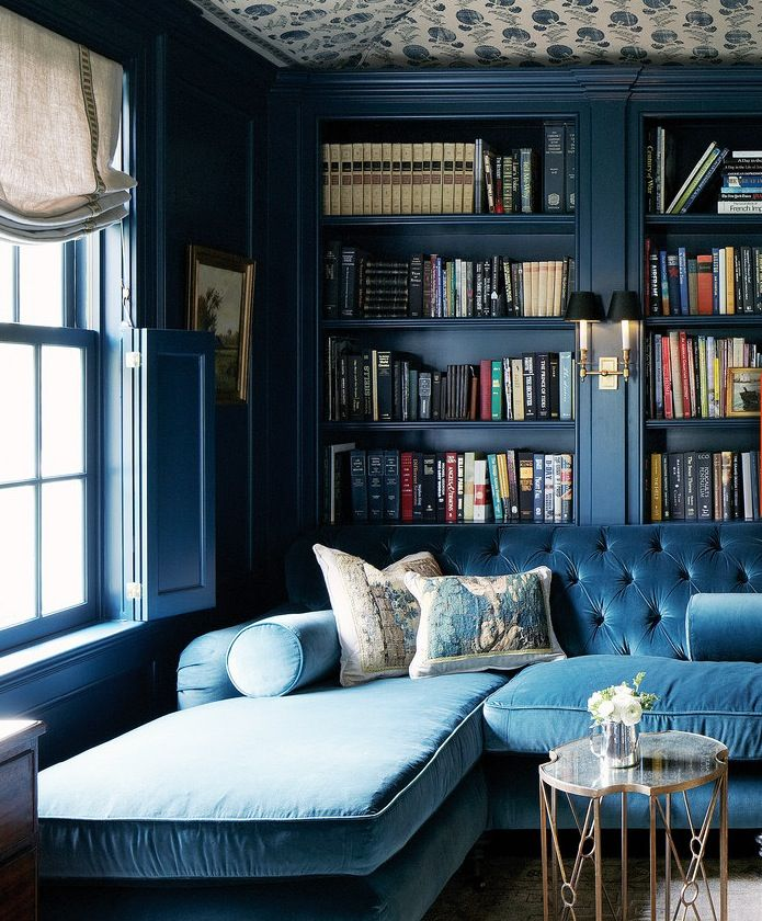Rich monochromatic color palette: blue library and blue velvet sofa. House Beautiful June 2013.