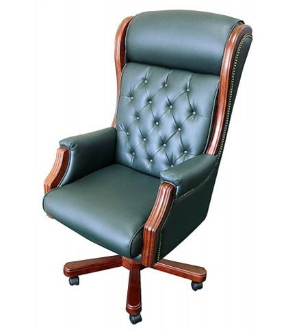 Комфортное вращающееся кресло руководителя в кожаной обивке темно-зеленого цвета. Эта и другие респектабельные модели кресел для руководителя бизнес-класса представлены на нашем сайте http://elpaso-studio.ru/168--