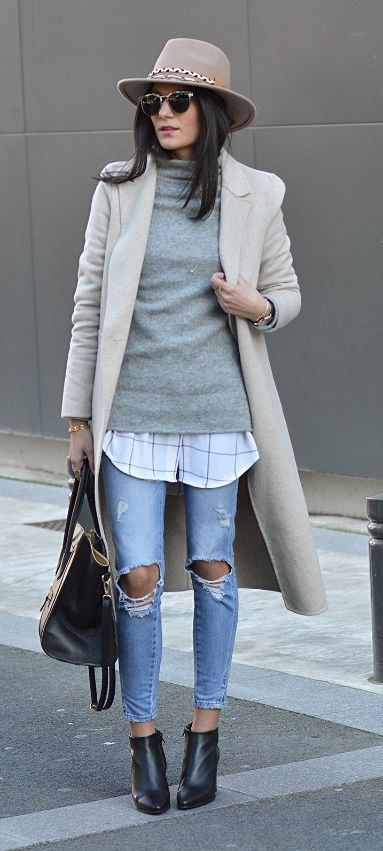 An ultimate cool-girl layered ensemble that centers around a woolen sweater. Starting with ripped jeans, add on a long button-down shirt plus a sweater. Accessories are entirely optional, but what a difference they make! #winteroutfits #winterlayers