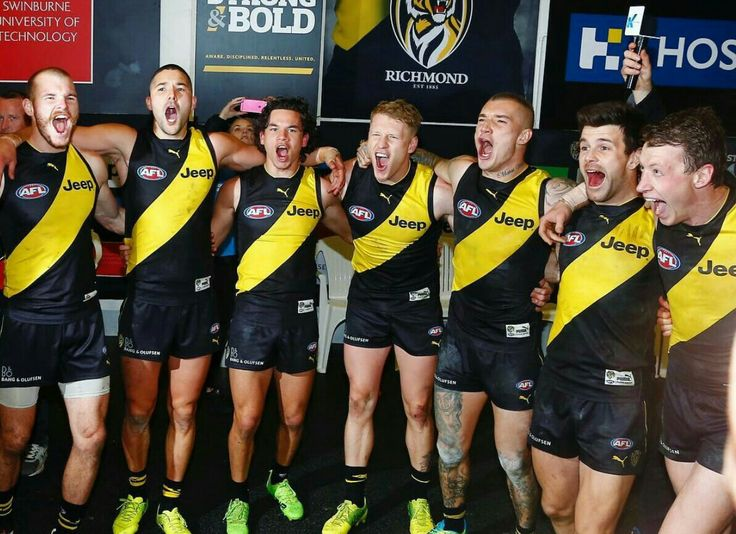 From left to right, Kamdyn McIntosh, Shaun Grigg, Daniel Rioli, Josh Caddy, Dustin Martin, Trent Cotchin, Dylan Grimes
