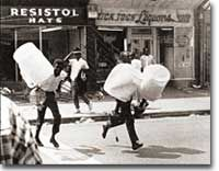 Nearly 4000 people were arrested for various crimes, including looting, during the Watts riots of the 1960s.