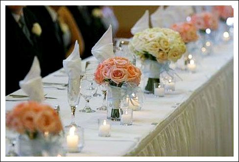 head table decor using bridemaids flowers | ... them along the front of the head table instead of bridesmaid bouquets