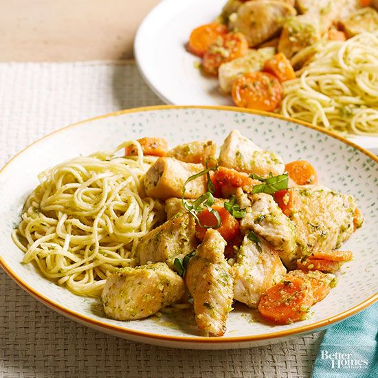 You can toss together this quick dish of angel hair pasta, grilled chicken, basil pesto, carrots, and parmesan cheese in minutes./