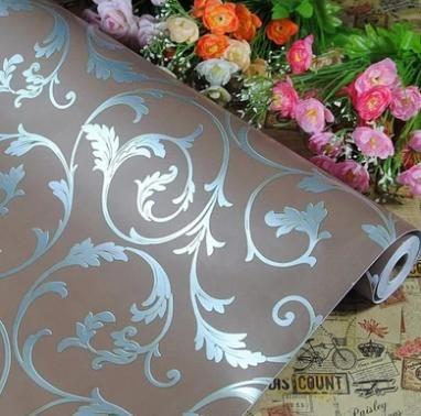 * Vloer- en muurbekleding: Dit is behang voor de accentmuur -> muur achter het bed.