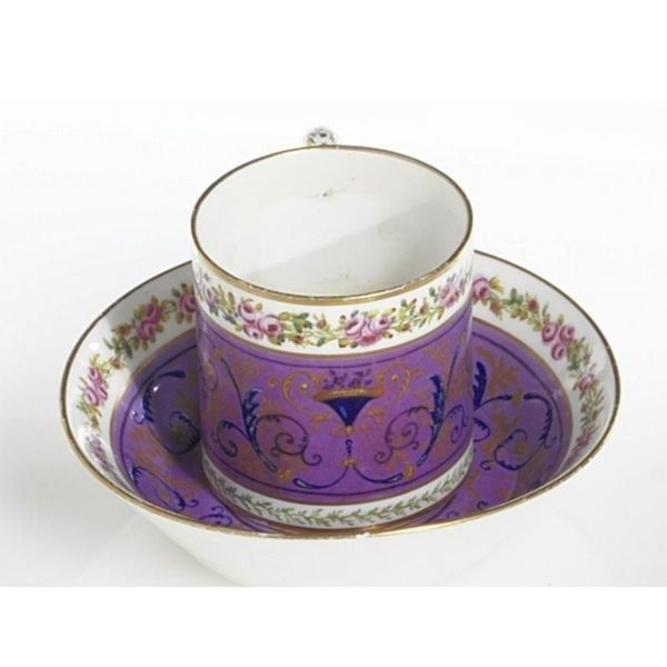 A SÈVRES LILAC-GROUND COFFEE CUP AND SAUCER