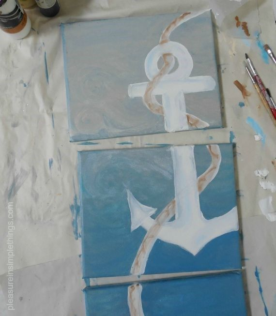 Trio of DIY canvas paintings depicting one ship anchor in shades of blue. Image only >aaaaAnchorpaintings-026.jpg (570653) #Coastal #anchor #art