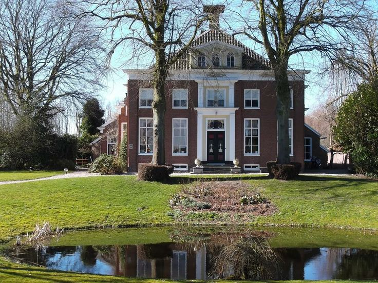 Farm in Groningen (NL), in this region farmers became so rich around 1900, that they could built beautiful houses like this. This type of farm is called 'Oldambtster boerderij', the barn is an extension of the house.