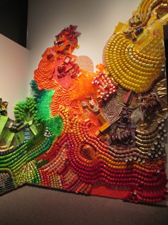 Lisa Hoke wall collage - paper and plastic cups, boxes and candy wrappers
