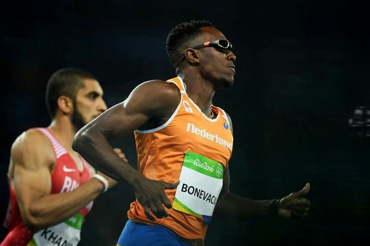 RIO DE JANEIRO, BRAZIL - AUGUST 12: Ali Khamis Khamis of Bahrain and Liemarvin Bonevacia of the Netherlands compete during the Men's 400m Round 1 on Day 7 of the Rio 2016 Olympic Games at the Olympic Stadium on August 12, 2016 in Rio de Janeiro, Brazil. (Photo by Matthias Hangst/Getty Images)
